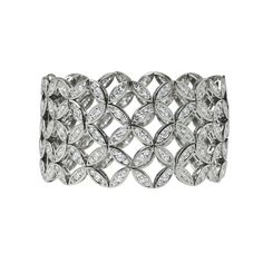 Inspired by Asian garden pathways, this Japanese Lattice diamond cuff bracelet has 22.12 carats of diamonds. See the best colourful and dreamy jewellery from an Oriental fashion and garden inspired collection by Ming Lampson in London: http://www.thejewelleryeditor.com/jewellery/article/ming-lampson-oriental-garden-jewellery-collection/ #jewelry