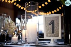 Bridal Bliss Wedding: Table numbers had photos on the back of them with a photo of the bride & groom each at that age.