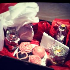 """Valentine's ideas: mason jars filled with candy, """"messages in a bottle"""" of all the reasons you love him, date nights for the rest of the year, homemade chocolate cupcakes with raspberry icing, and whatever fun gifts you want to include."""