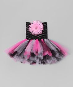 Tutu with crocheted bodice and a removable floral pin.
