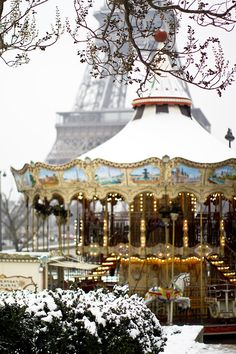 Carousel in the snow at the Eiffel Tower.