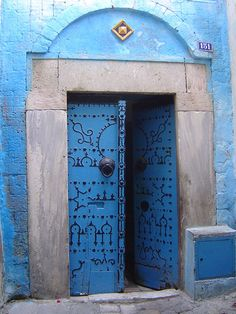 I'm obsessing over these blue doors from Tunisia. I love, love this blue. Whatever home I have will have these gorgeous blue doors.