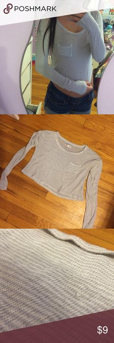 HOLLISTER striped cropped sweater XS HOLLISTER grey and cream striped sweater. Very thin, lightweight, soft material. Size xs. Gently used condition, slight pilling/pulls in areas as shown in pics. Hollister Tops Crop Tops