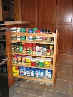 very handy accessory, spice or canned good pull out. variety of sizes! cherry wood with spice stain, by Oceanside Cabinets