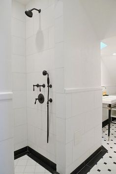 I would like the inside of the shower to look similar to this (?) I like the large shower tiles as well as the dark shower knobs/facets.