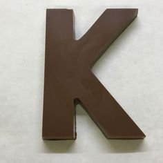 The letter K made of milk chocolate. Chocolate Letters, Letter K, Pantone Color, Color Trends, Milk, Cakes, Products, Cake Makers, Kuchen