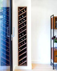 Carefully detailed custom walnut wine rack is slotted discretely into the livin. Carefully detailed custom walnut wine rack is slotted discretely into the living room wall Built In Wine Rack, Wine Rack Storage, Wine Rack Wall, Wall Storage, Wine Rack Cabinet, Diy Wine Racks, Wine Bottle Storage Ideas, Kitchen Wine Racks, Wooden Wine Racks