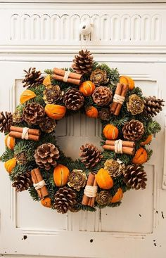 21 DIY Christmas Wreaths to Make Now! - Sharp Aspirant Thinking of making your own Christmas wreaths? You're going to love these fun and creative Christmas wreaths ideas! They're simple and easy to make and don't cost too much. Christmas Tree Decorating Tips, Rustic Christmas Ornaments, Christmas Door Wreaths, Christmas Door Decorations, Christmas Centerpieces, Christmas Crafts, Christmas Holidays, Orange Christmas Tree, Christmas Design