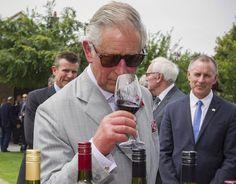 Prince Charles sniffs wine before tasting at Tanunda, South Australia