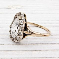 1.42 Carat Pear Shaped Diamond Antique Engagement Ring  from Erstwhile Jewelry Co.    Circa 1860    * Please note that the center pear shape diamond was originally used as a bead among many in an old necklace in the early part of the 19th century. That being said, on the very corner of the pear sha...