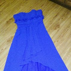 Royal blue prom dress size 14 high low High low royal blue size 14 ladies prom dress with flowers under the bust and thin straps, in good condition...smoke free home.... Bust 40 Waist 36 Hips 46 Length 61 Andrew Adela Dresses High Low