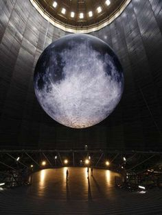 """""""Largest Moon on Earth"""" Sculpture and Photo by Wolfgang Volz; Located in a Former Gas Container.  Via eco-log.de/sternstunden-wunder-des-sonnensystems"""