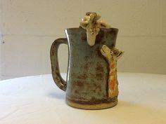 Giraffe mug by MudHutPottery on Etsy, $20.00. Totally adorable 3d giraffes