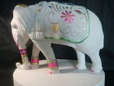 Portand stone Painted Coloured Tinted Patinated Enamelled Sculptures Statues statuettes sculpture by artist Duncan Park titled: 'White Elephant (Small Carved Decorated Elephant statuette carving)'