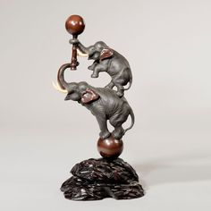 JAPANESE BRONZE TWO ELEPHANTS BALANCING ON BALL Just Japanese Antiques is located in Chichester, England.