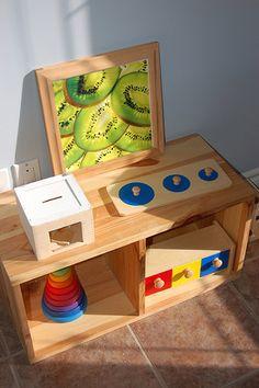 Montessori toddler bedroom shelves. I like the dressing/mirror area for Grey.