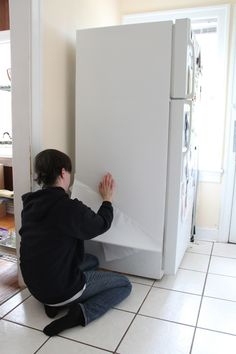 Ugly (and dirty, old) fridges can be a problem in rentals. But you can disguise them without permanently altering them. We Can Make Anything has the instructions. First I lined the side of my refrigerator with white contact paper.