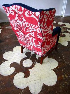 Chairloom, dramatic floor stencils, white paint on wood, wingback chair, red and white fabric,
