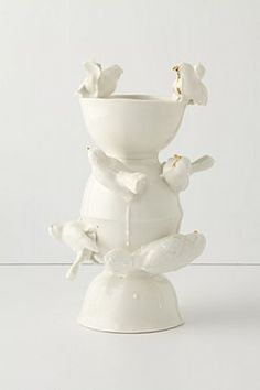 Ahh...Anthropologie.com...these porcelain birds with the golden beaks are delightful.  Do they lay golden eggs?