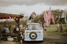 This couple had the coolest festival wedding complete with bunting, flags and a cocktail campervan.