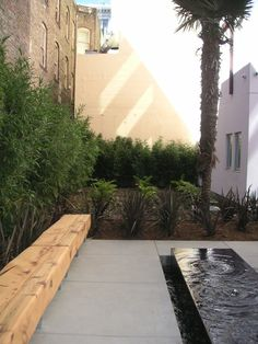 Water feature / bench / cement patio Curran house by Andrea Cochran
