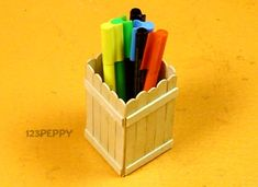 A Simple Pen Holder  Materials for Simple Pen Holder craft        Popsicle sticks      Adhesive      Glossy glue      Scissors      Flat brush    Time Required: 20 Minutes