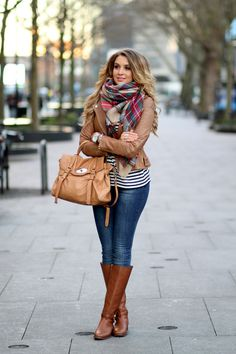 Light brown leather jacket, plaid scarf riding boots hair down.