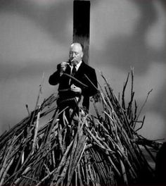 Promotional portrait of Britishborn American film and television director Alfred Hitchcock as he lights a cigarette while tied to a stake above a. Alfred Hitchcock, Hitchcock Film, Tv Movie, Silent Film, Film Director, Old Hollywood, Horror Movies, Horror Fiction, Filmmaking
