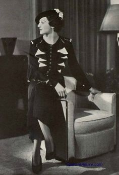 Chanel, 1936. Black afternoon dress. The ruffles at the front bodice and down the sleeves are lined in white.