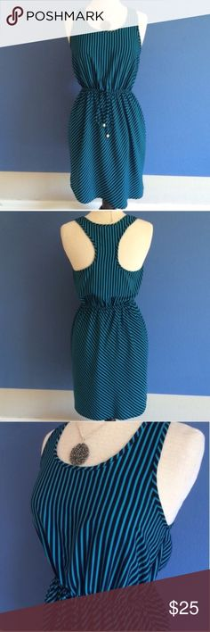 "Soprano Racerback Striped Dress You will be both comfortable and cute on this dress.  This Teal and navy piece is perfect for any occasion. Material:  100% Polyester. Measurements : Length - 36.5""/Bust - 18""/Waist - 13.5"" Soprano Dresses Midi"