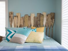 Upcycle wooden paddles into a creative headboard. Get more DIY headboard ideas here >> http://blog.diynetwork.com/maderemade/2015/10/13/20-ideas-for-20-dollar-headboards/?soc=pinterest