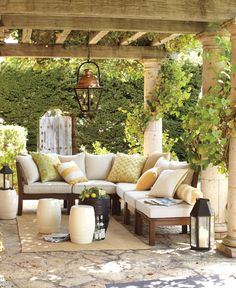 Pergola, creepers, corner sofa and large lanterns.
