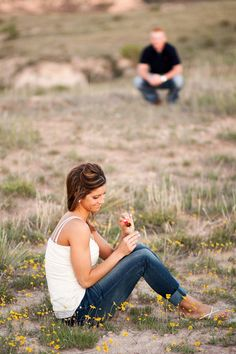 """""""You go crouch over there by yourself while I admire this ring!"""" """" Lets just blur out my fiancé completely, I really just like the ring in this picture""""  what a weird engagement photo!! I didn't even write this comment but it's funny and true"""