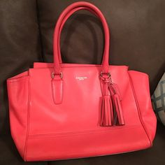 Authentic Coach Good condition.Comes from smoke free and pet free home.Thats the real colo on it.No editing.I don't know if its really orange or red. So im going to say it's red orange. Coach Bags Shoulder Bags