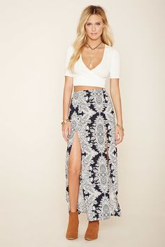 A maxi skirt featuring an ornate print, with a front M-slit, and an elasticized waist.