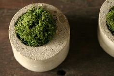 concrete pots - easy to make.  I like the off-center hole.