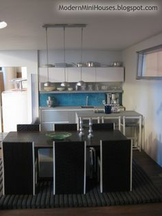 love this modern miniature kitchen and dining room.