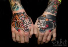 Tiger and panther hand tattoos by Myke Chambers #InkedMagazine #tiger #panther #inked #tattoos #tattoo #hands