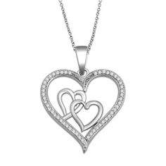 With its sweet design featuring a larger heart surrounding two smaller ones, this delightful pendant could be a metaphor for your romantic love story. Fashioned in 10K white gold, a looping open heart, beautifully outlined with shimmering diamonds, cuddles two smaller linked hearts in a sparkling embrace. Radiant with 1/7 ct. t.w. of diamonds and finished with a bright polished luster, this heart pendant suspends close to hers from an 18.0-inch rope chain that secures with a spring-ring…