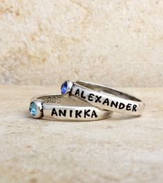 Our birthstone rings are available in all the birthstone colors. They can be custom stamped and stacked together. The birthstones are Swarovski crystal (approximately 3mm) and set into our sterling bands. What a great way to commemorate a child's birth! Simply select your size, birthstone and let us know what you would like stamped on your ring. There is a maximum of 12 characters.