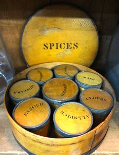 Large round spice box with eight canisters.