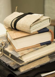bookbinding, love the linen soft cover with leather strap on top!