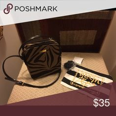 Nine West purse with makeup bag Nine West black and brown zebra print purse with black and white makeup bag that has a fur ball on the side. Nine West Bags Shoulder Bags