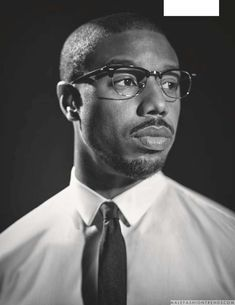 Promoting the release of Black Panther, Michael B. Jordan appears before the lens of photographer Gavin Bond for the occasion. Black Panthers, Gq, Black Man With Glasses, Michael Bakari Jordan, Bond, Black Noir, Handsome Black Men, Power To The People, Moda Masculina