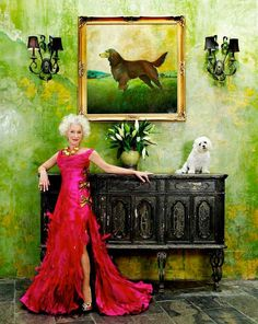 I find everything about this picture breathtaking - the dress, the colors, Helen Mirren, those walls, the sideboard, the dogs - all of it.