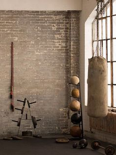 home gym, but it needs one wall with a POP of color and an inspirational motto…