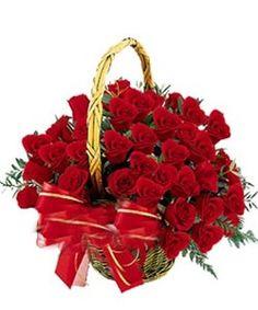 Round arrangement of around 40 red roses.