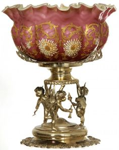 """12 1/2"""" X 10 1/2"""" BRIDES BASKET : PINK SATIN HERRINGBONE MOTHER-OF-PEARL MELON RIBBED BOWL WITH ENAMEL FLORAL DECOR, PALE GREEN SATIN INTERIOR. SET ON ORNATE BERBY SILVERPLATE AND FEATURING THREE WINED CHERUBS"""