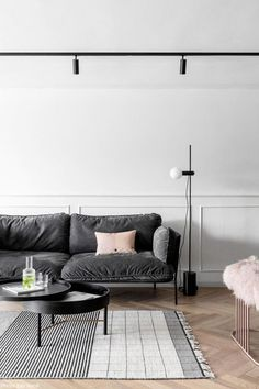 The owners of this apartment in Israel have chosen strict minimalism and a black and white color scheme with pink accents. The home is divided into two ✌Pufikhomes - source of home inspiration Living Room Sofa, Living Room Decor, Living Spaces, Living Area, Bedroom Decor, Grey Velvet Sofa, Best Flooring, Home And Living, Clean Living