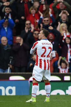 Stoke City's Swiss forward Xherdan Shaqiri celebrates scoring their third goal during the English Premier League football match between Stoke City and Hull City at the Bet365 Stadium in Stoke-on-Trent, central England on April 15, 2017. / AFP PHOTO / Oli SCARFF / RESTRICTED TO EDITORIAL USE. No use with unauthorized audio, video, data, fixture lists, club/league logos or 'live' services. Online in-match use limited to 75 images, no video emulation. No use in betting, games or single…